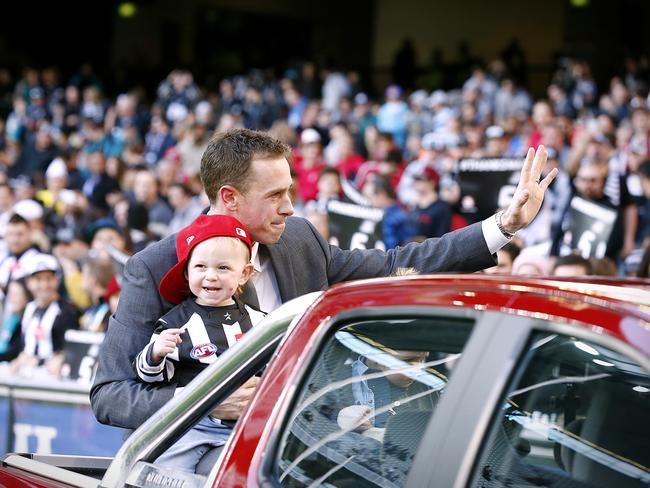 Nick Maxwell and his son Archie in the back of Dayne Beams' Holden 4x4 on Sunday. Picture: Wayne Ludbey