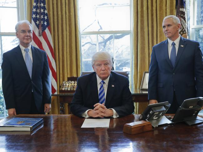 President Donald Trump, flanked by Health and Human Services Secretary Tom Price and Vice President Mike Pence, addresses the media about his failed health care bill. Picture: AP/Pablo Martinez Monsivais