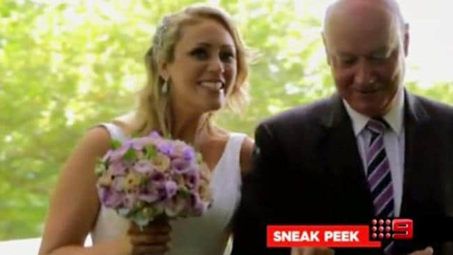 Clare Verrall looks pretty happy as she walks down the aisle.