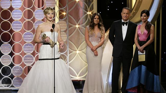 "Tom Hanks looks confused as Jennifer Lawrence accepts the award for best supporting actor in a motion picture for her role in ""American Hustle,"" at the Golden Globes."