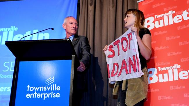 Anti-Adani protesters storm the stage at Townsville leaders forum. Picture: AAP/Tracey Nearmy.