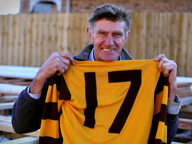 Michael Tuck was captured on a building site with his No. 17 jumper from the 1991 premiership, the last jumper he wore in an AFL match. Picture: Wayne Ludbey