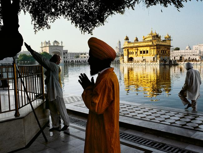 Steve McCurry: India exhibtion - Sikh devotee prays at the Golden Temple, Amritsar, Punjab, 1996. Picture: Steve McCurry