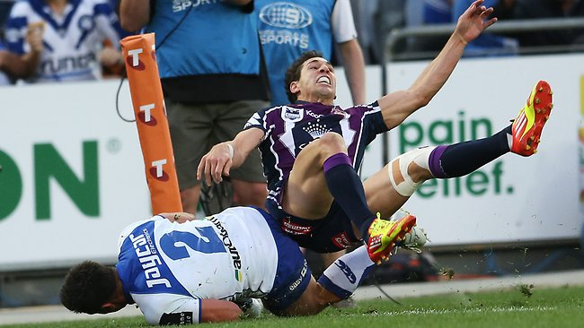 Billy Slater hits Sam Perrett late after the Bulldog scored a try. Picture: Phil Hillyard