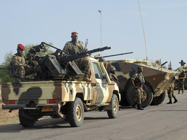 Belated action ... A convoy of soldiers reinforce troops deployed against Nigerian Islamist group Boko Haram. Boko Haram, which in April 2014 kidnapped more than 200 schoolgirls in northeast Nigeria .