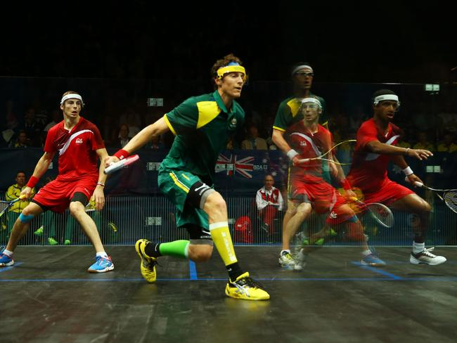 Adrian Grant and Nick Matthew of England and David Palmer and Cameron Pilley of Australia compete in the men's doubles gold medal match.