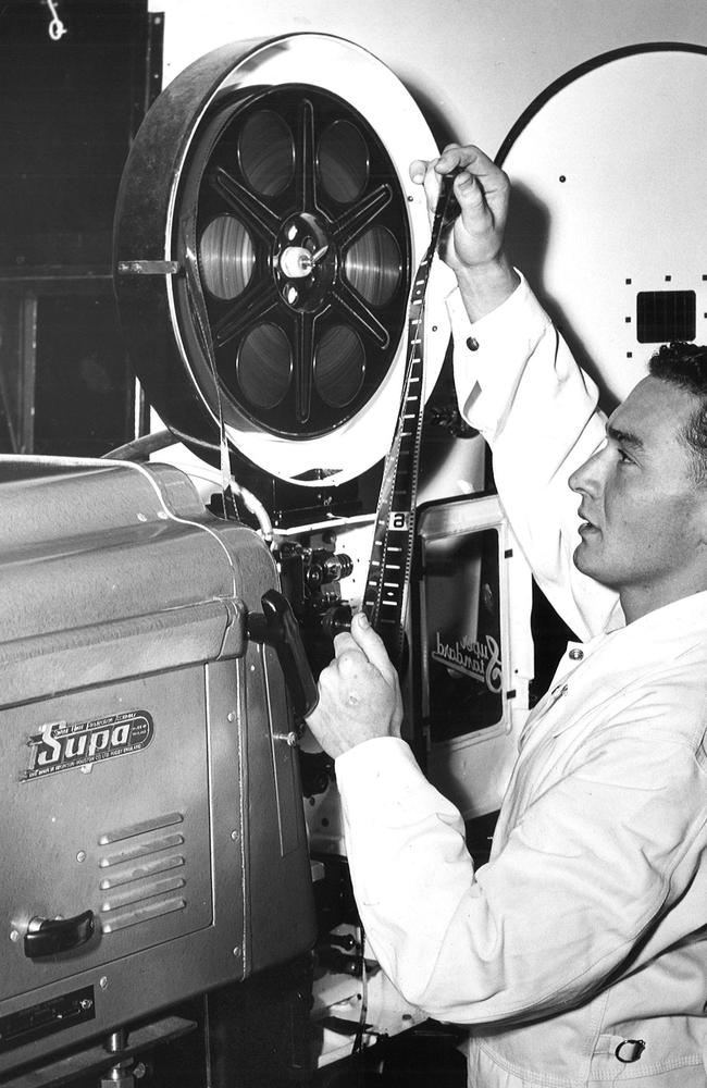 Projectionist Ron McCracken pictured operating the high-powered projection equipment at the Essendon Drive-In in 1956. Picture: Herald Sun Image Library/ARGUS