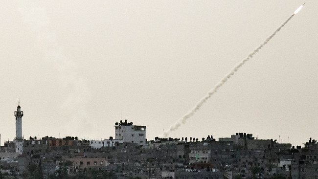 A picture taken from the southern Israeli Gaza border shows a rockets being launched from the Gaza strip into Israel. AFP PHOTO / JACK GUEZ