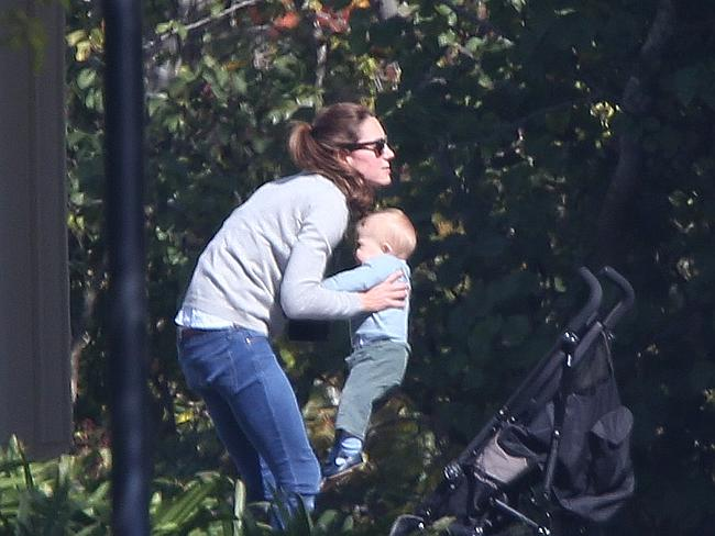 Kate lifts George out of his pram for a cuddle. Picture: News Corp