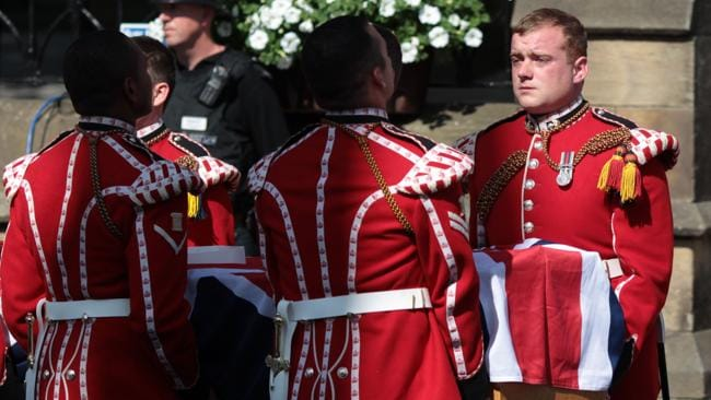 Royal Fusiliers carry the coffin of Lee Rigby into Bury Parish Church in Bury, northwest England. Picture: AFP