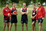 Melbourne draftees (from left) Jimmy Toumpas, Matt Jones, Dean Terlich and Dean Kent listen to coach Mark Neeld. Picture: Klein Michael
