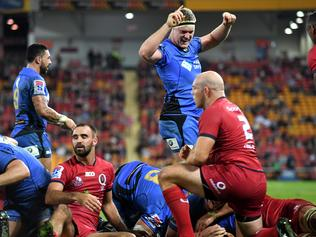 Matt Philip of the Western Force (centre) celebrates scoring a try during their Round 14 Super Rugby game the Queensland Reds at Suncorp Stadium in Brisbane, Friday, May 26, 2017. (AAP Image/Dan Peled) NO ARCHIVING, EDITORIAL USE ONLY