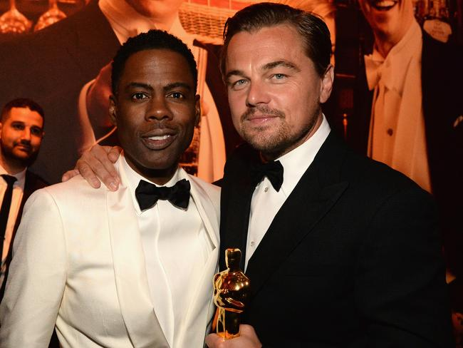 Leo's night... Best Actor winner for 2016 Leonardo Dicaprio poses with host Chris Rock at the 2016 Vanity Fair Oscar Party. Picture: Kevin Mazur/VF16/WireImage