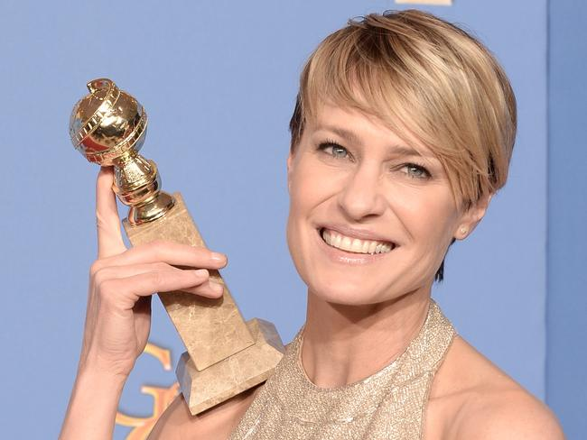 Renaissance ... Wright with her Golden Globe for  <i>House of Cards</i>. Picture: Kevin Winter