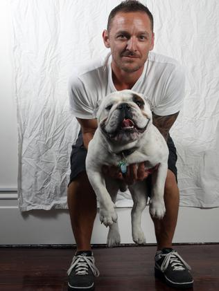 Adam Newman, who owns the salon Men's Room in Hindley St, with his pet British bulldog Lenny.