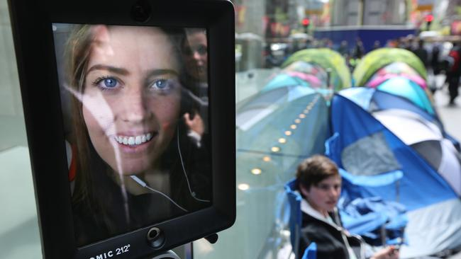 Lucy the robot was first in line. People waiting outside the Apple store in George St for the iPhone 6S. Photo: Bob Barker.
