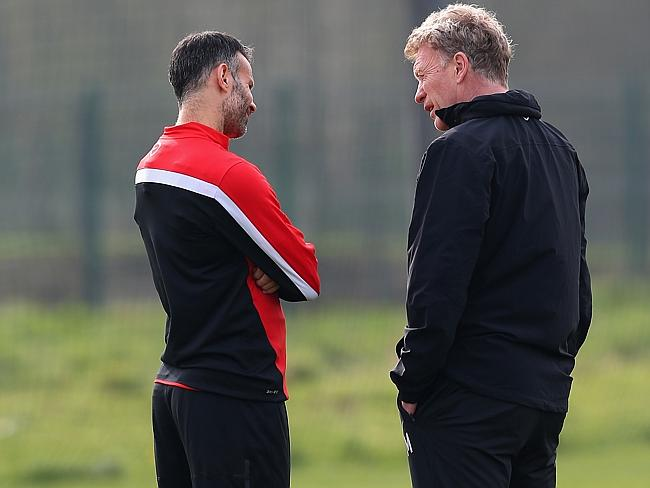 Moyes chats to Ryan Giggs, who has played sparingly under him amid reports they don't get