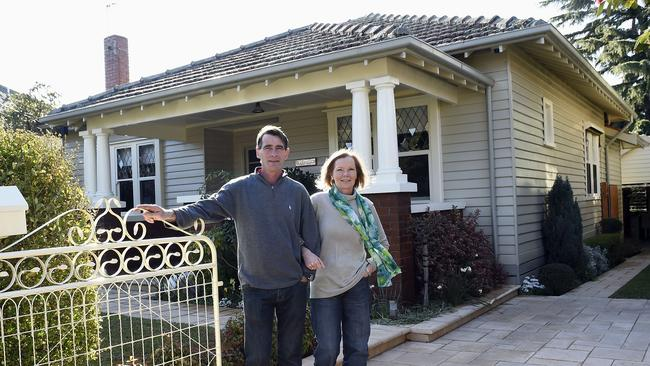 Ian and Lorraine Ross in the front garden of their home at 47 Brisbane St, Ascot Vale.