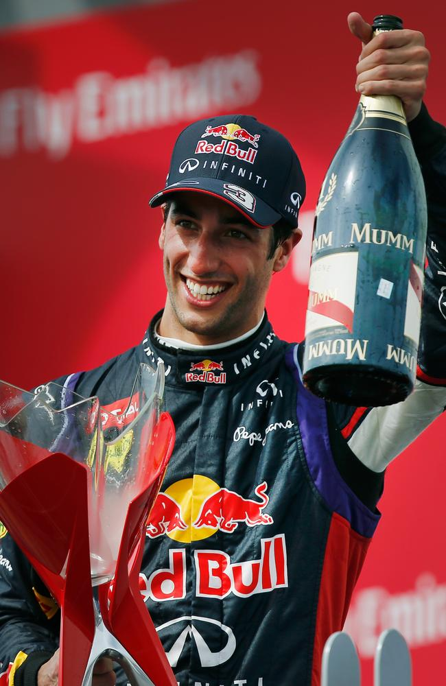 Daniel Ricciardo of Australia and Infiniti Red Bull Racing celebrates his maiden victory during the Canadian Formula One Grand Prix.