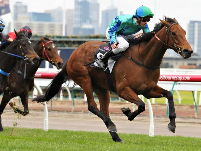 Regan Bayliss on his way to his first Flemington winner from his first Flemington ride Picture: Getty Images