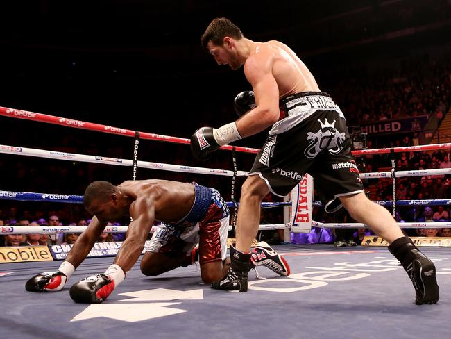 Yusaf Mack is knocked down by Carl Froch during their world title fight in England.