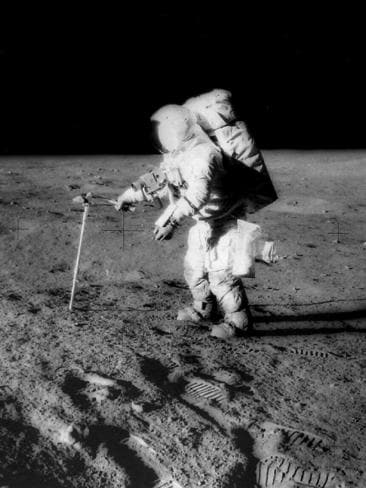 Astronaut Alan Bean taking a core sample on the Moon's surface in November 1969. Picture: NASA.