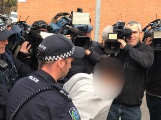 A screenshot taken from a video of a teenager being rearrested outside the Youth Court in Adelaide, Tuesday, August 22, 2017. Three teenagers have been released and then re-arrested over a fatal hit and run which claimed the life of Lucy Paveley at suburban Parafield. (AAP Image/Tim Dornin) NO ARCHIVING