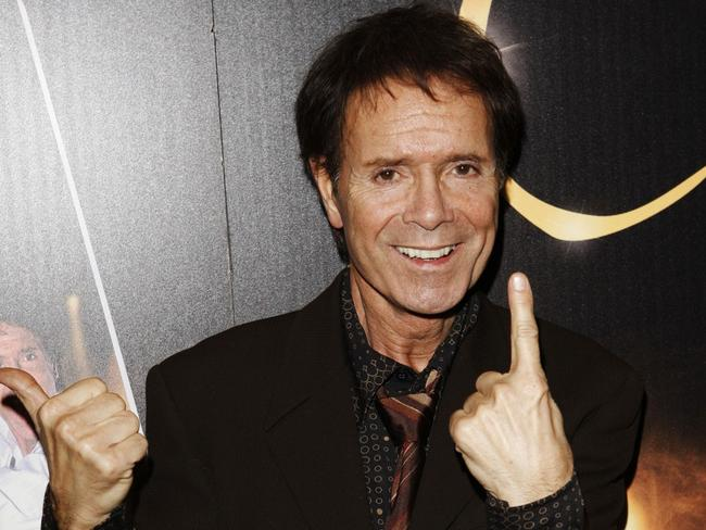 British singer Cliff Richard poses for photographers at a photo call promotion celebrating his 50th anniversary in the music industry in London, Friday, Dec. 5, 2008. (AP Photo/MJ Kim)