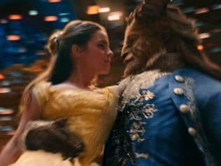 Belle (Emma Watson) comes to realize that underneath the hideous exterior of the Beast (Dan Stevens) there is the kind heart of a Prince in a scene from Disney's BEAUTY AND THE BEAST, a live-action adaptation of the studio's animated classic film Directed by Bill Condon.