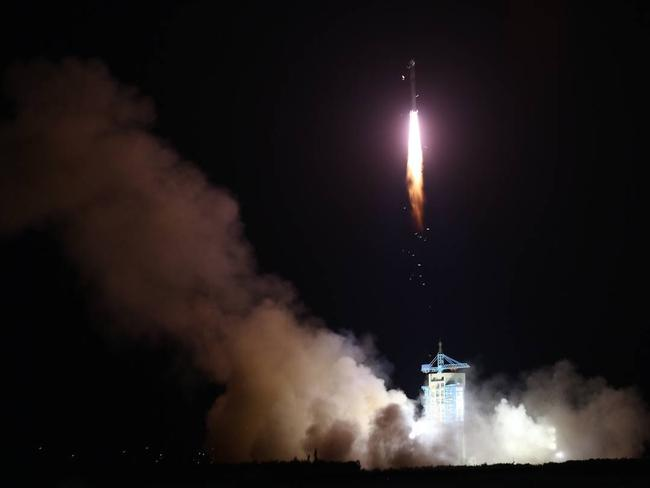 China launched the world's first quantum satellite on top of a Long March-2D rocket from the Jiuquan Satellite Launch Center in northwest China. Picture: Zuma