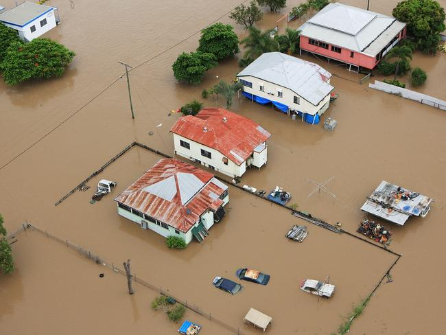 Catastrophic floods ... Homes surrounded by flood waters in Rockhampton on January 6, 2011. Photo: Jonathan Wood/Getty Images