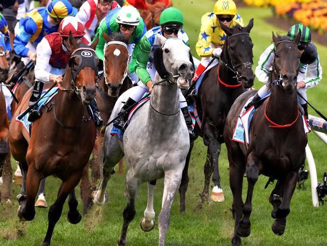 Chad Schofield settles eventual winner Shamus Award at the front of the field in last year's Cox Plate as the contenders pass the post on the first occasion. Picture: Jay Town