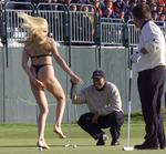 <p>Tiger Woods being approached by streaker</p>
