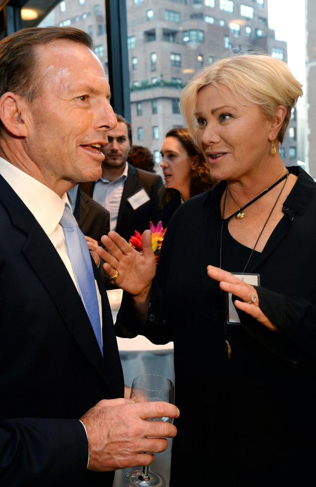 Keeping up with the Jackman's... Tony Abbott chats with Hugh Jackamn's wife Deborra-Lee Furness at a reception in New York yesterday. Picture: Jake Nowakowski