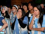 Misery ... Eli Barbalace and Daiana Barbalace, along with their fellow Argentina supporters, are disappointed by the South American country's narrow loss. Picture: Noelle Bobrige