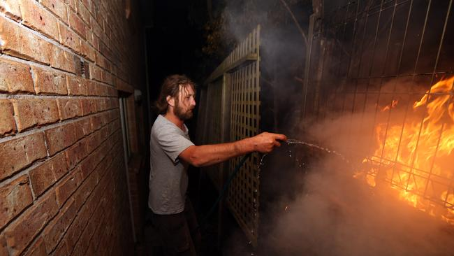 Tathra resident Julian Brown, 33, fought a spot fire at the back of his house in the early hours of the morning.