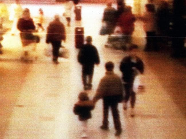 A surveillance camera shows the abduction of two-year-old James Bulger on February 12 1993 near Liverpool, England. Bulger holds the hand of Jon Venables. Picture: BWP Media via Getty Images