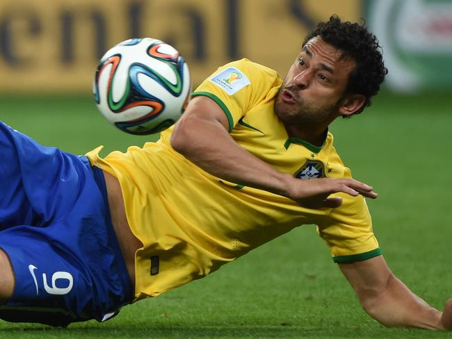 Floored ... Brazil's forward Fred eyes the ball during the semi-final football match between Brazil and Germany.