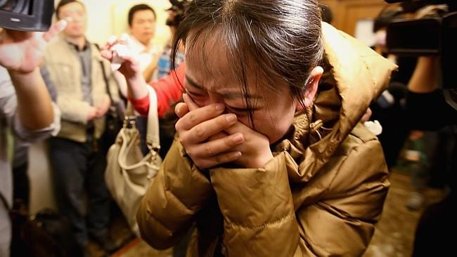 A relative of a passenger onboard Malaysia Airlines flight MH370 cries out at a local hotel where families are gathered. Picture: Feng Li/Getty Images