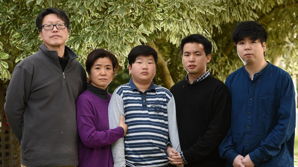 David Lee with his family, Jessica, Richard, Daniel and Bryan, who have lived in Glen Waverley for nine years and are facing deportation to Korea next week. Picture: David Smith.