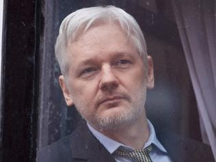 "(FILES) This file photo taken on February 05, 2016 shows WikiLeaks founder Julian Assange is seen through the window of the door leading to the balcony of the Ecuadorian embassy in central London on February 5, 2016 from where he addressed the media. WikiLeaks said on January 18, 2017 its founder Julian Assange could travel to the US to face investigation after one of the site's main sources was given clemency -- but only if his rights were ""guaranteed"". / AFP PHOTO / BEN STANSALL"