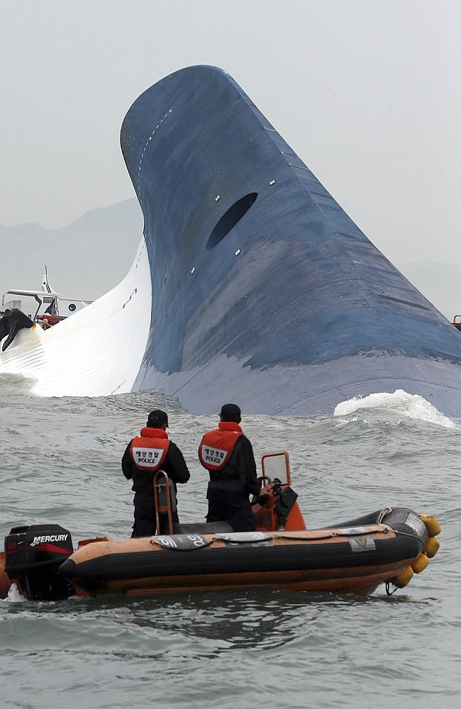 South Korean coast guard officers look at the keel of the Sewol ferry. Picture: Hyung Min