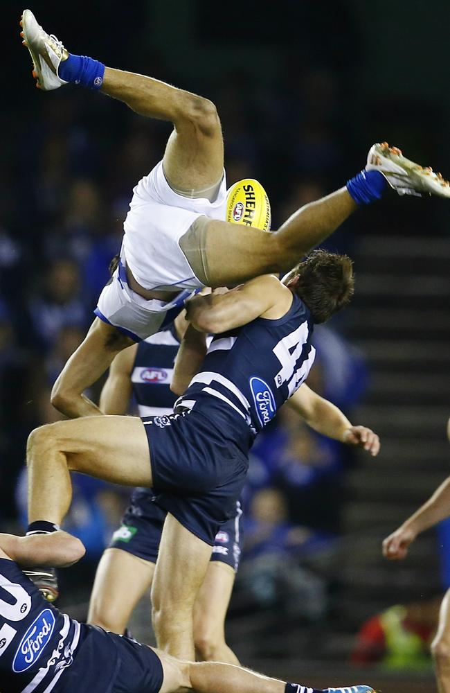 Lindsay Thomas flies high but comes down on his head. Picture: Michael Klein