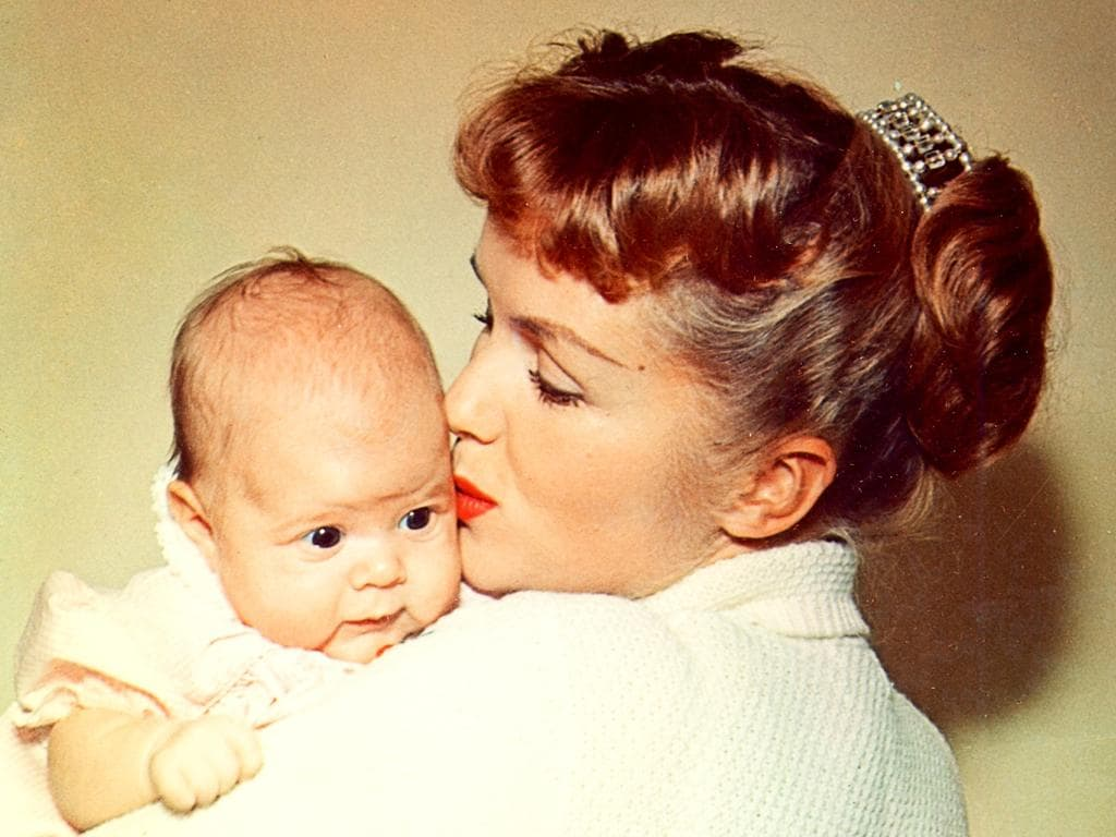 Hollywood family...Bright Lights documentary shares the family secrets of Debbie Reynolds, pictured with baby daughter Carrie Fisher. Picture: Supplied