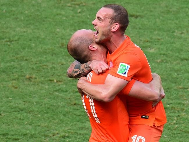 Netherlands' forward Arjen Robben (left) celebrates with Wesley Sneijder their victory at the end of a Round of 16 football match between Netherlands and Mexico. AFP PHOTO/ JAVIER SORIANO