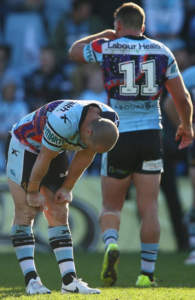 Jeff Robson and Chris Heighington of the Sharks look dejected.