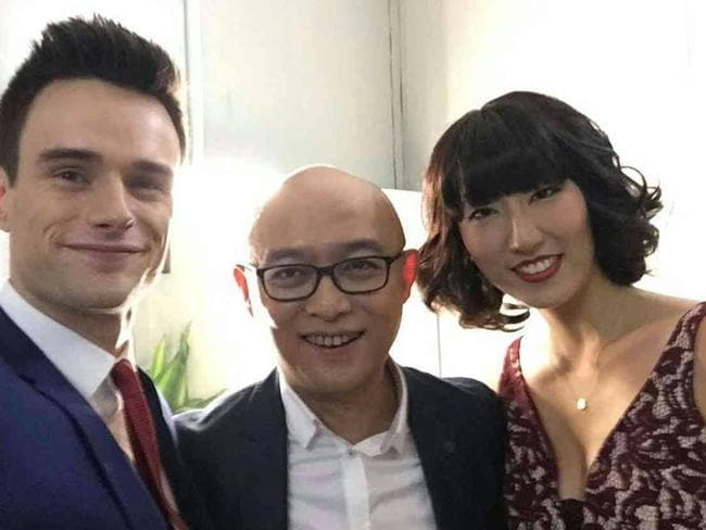 The couple pictured with show host Meng Fei in his backstage room.