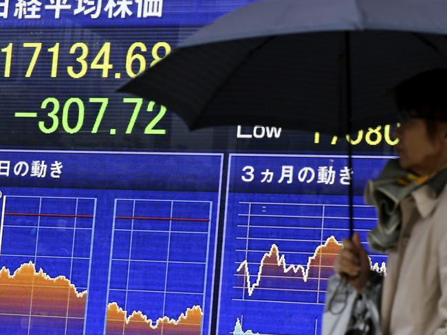 Shares fell in Asia Wednesday and the volatility index rose amid fears a Trump presidency could harm the global economy. Picture: AP Photo/Shuji Kajiyama.