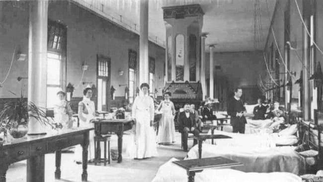 Light Ward, in 1906, with a male and female doctor on their rounds. Picture: Heritage Office Royal Adelaide Hospital