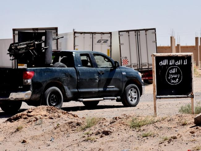 A billboard shows the logo of the Islamic State (IS) group near the village of al-Malihah, in the northern countryside of Deir Ezzor. Picture: George Ourfalian/AFP
